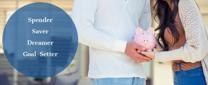 couple holding a pink piggy bank