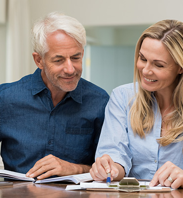 Older couple working on finances